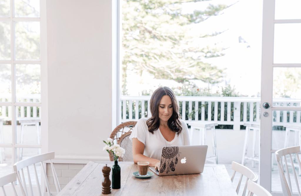 Cassie Mendoza-Jones working on her laptop